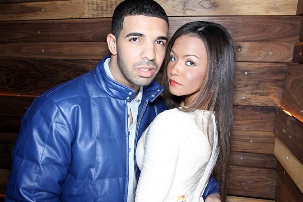 Dollicia Bryan y Drakeposando para una fotografía