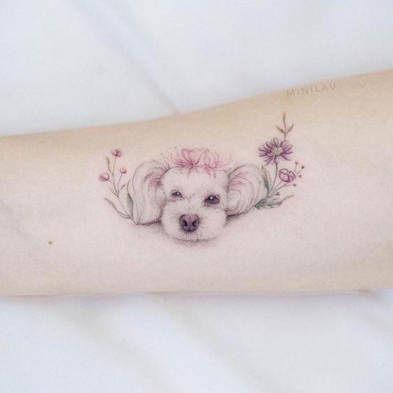 Perrita con efecto acuarela ;15 Hermosos tatuajes para mostrar que eres una 'animal lover'