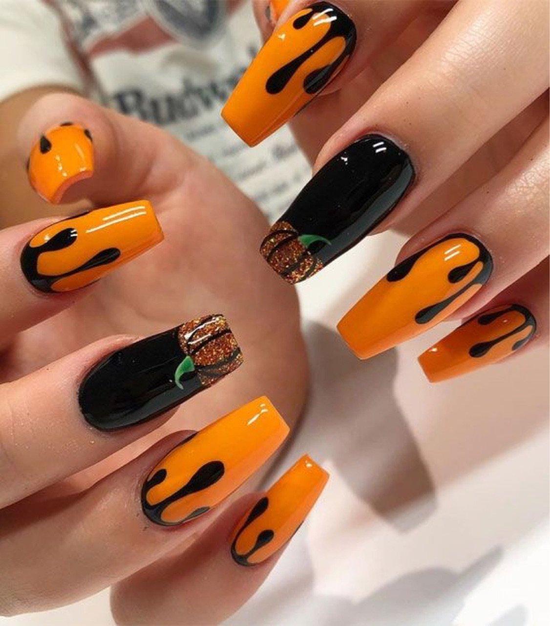 Manicura en tonos naranja; 18 Manicuras a las que tu brujita interior no se resistirá